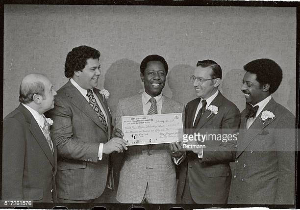 Atlanta Brave's superstar Henry Hank Aaron accepts a $1015000 check from the City of Atlanta and the Atlanta Chamber of Commerce here on February...