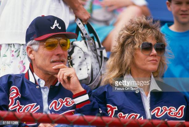 Atlanta Braves team owner Ted Turner is seen with wife Jane Fonda in the stands during a 1991 season MLB game
