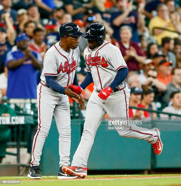 Atlanta Braves third baseman Adonis Garcia is congratulated by third base coach Ron Washington during a game against the Houston Astros at Minute...