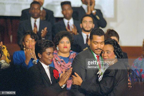 Atlanta Coretta Scott King hugs her youngest son Dexter after passing the torch of the presidency of the Martin Luther King Jr Center for Nonviolent...