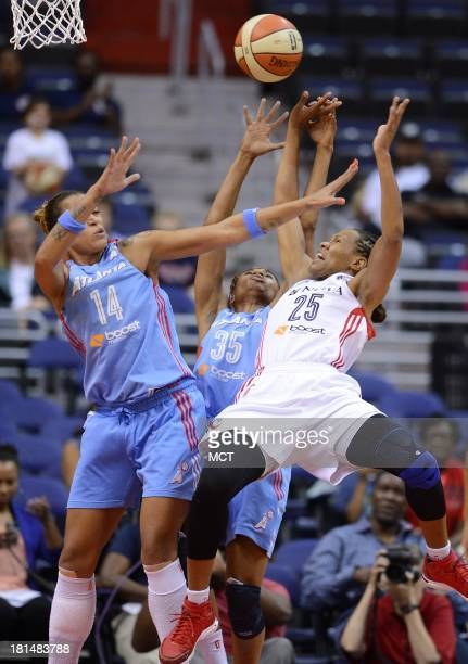 Atlanta Dream guard Angel McCoughtry commits a blocking foul against Washington Mystics forward Monique Currie in the first quarter of Game 2 of the...