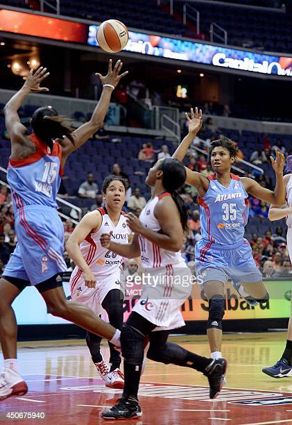 Atlanta Dream guard Angel McCoughtry tries to hit teammate Tiffany Hayes in stride with a pass during the fourth quarter against the Washington...