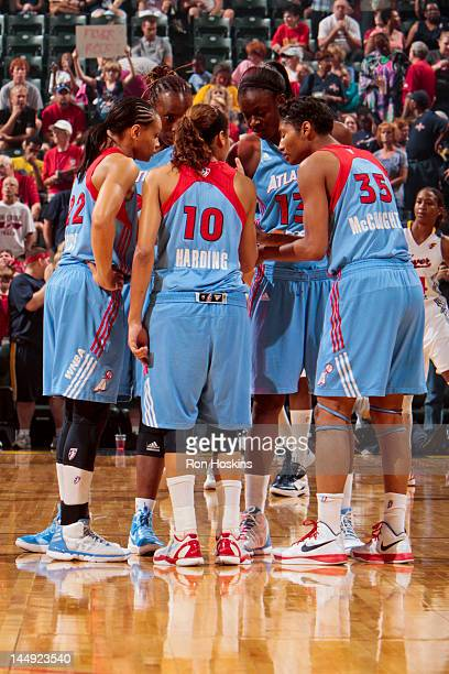 Atlanta Dream players Armintie Price Sancho Lyttle Lindsey Harding Aneika Henry and Angel McCoughtry huddle up while playing against the Indiana...