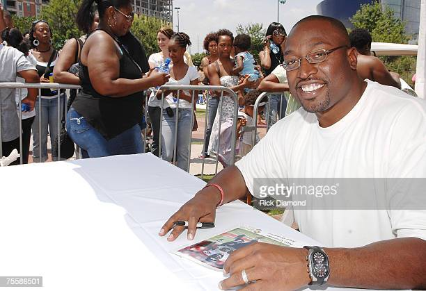 Atlanta Falcon Alge Crumpler sign autographs at Centennial Olympic Park on July 21 2007 in Atlanta Georgia as part of Dr Ian Smith's 'An Event to...