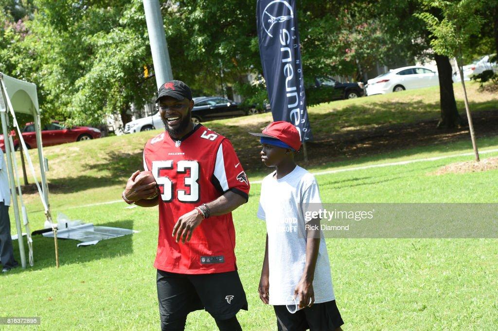 Atlanta Falcon Linebacker LaRoy Reynolds and guest play at 'Nickelodeon's Worldwide Day Of Play And Laureus Sport For Good In Atlanta' at Washington Park on July 17, 2017 in Atlanta, Georgia.