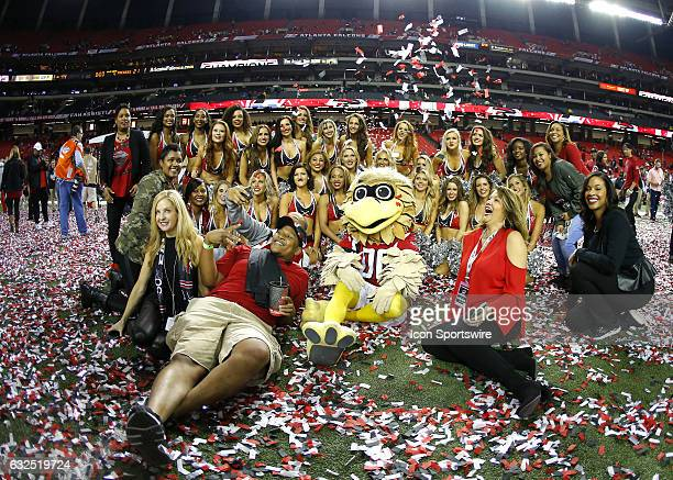 Atlanta Falcons cheerleaders and mascot Freddy Falcon celebrate the victory at the conclusion of the NFC Championship game between the Green Bay...