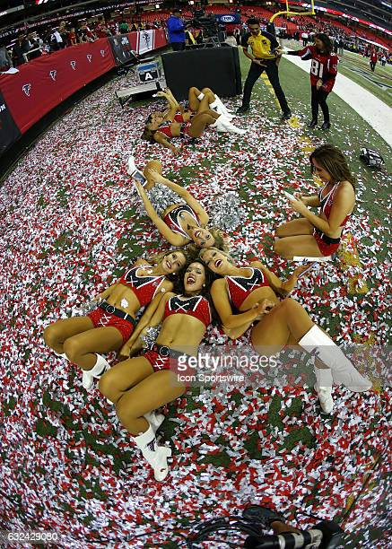 Atlanta Falcons cheerleaders celebrate in the confetti at the conclusion of the NFC Championship game between the Green Bay Packers and Atlanta...