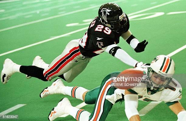 Atlanta Falcons' cornerback Randy Fuller knocks the ball away from Miami Dolphins' Todd Doxzon during the fourth quarter 27 December in Atlanta GA...