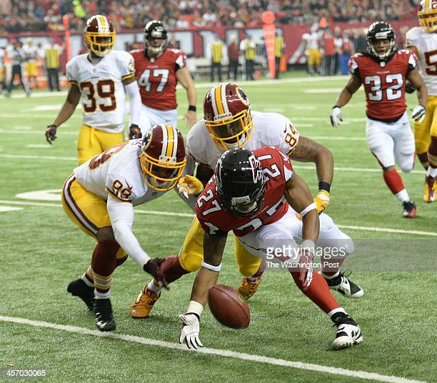 Atlanta Falcons cornerback Robert McClain recovers a punt that hit off Washington Redskins wide receiver Santana Moss during second quarter action at...