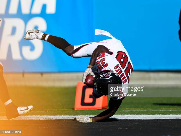 Atlanta Falcons cornerback Taveze Calhoun dives into the end zone for a touchdown after a punt return against the Carolina Panthers in the first half...