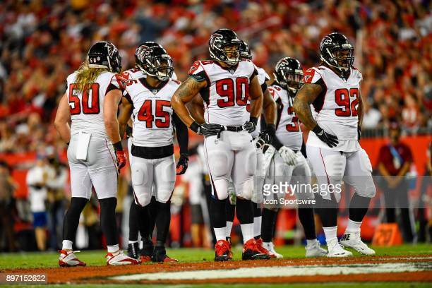 Atlanta Falcons defensive end Derrick Shelby Atlanta Falcons defensive tackle Dontari Poe and teammates wait for play to resume during an NFL game...