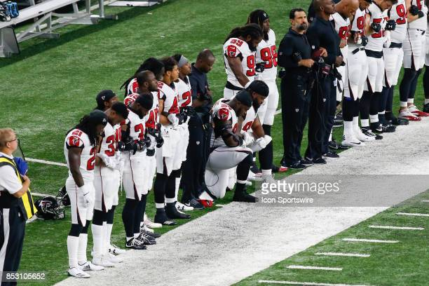 Atlanta Falcons defensive tackle Grady Jarrett and Atlanta Falcons tackle Dontari Poe kneel during the playing of the national anthem prior to the...