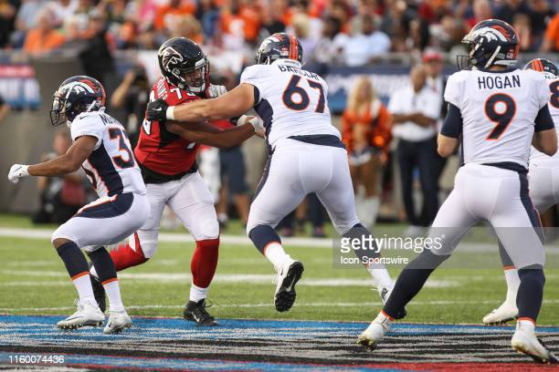 Atlanta Falcons defensive tackle Jacob Tuioti-Mariner fights through a block by Denver Broncos offensive guard Don Barclay during the Hall of Fame...
