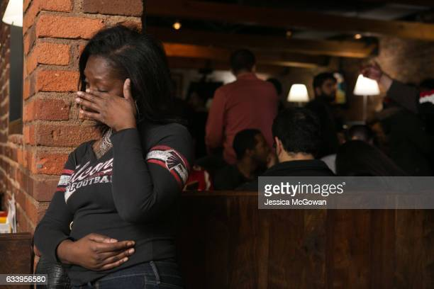 Atlanta Falcons fan Cicily Mitchell wipes away a tear after Atlanta loses against the New England Patriots during the Super Bowl 51 at STATS on...