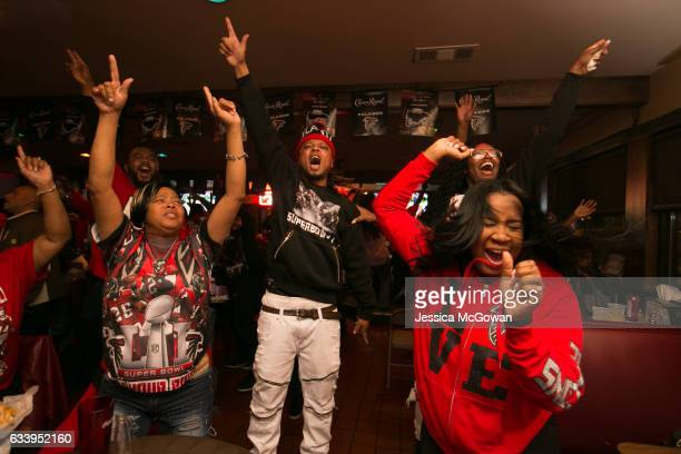 Atlanta Falcons fans cheer for their team while watching Super Bowl 51 against the New England Patriots at Dugan's bar on February 5 2017 in Atlanta...