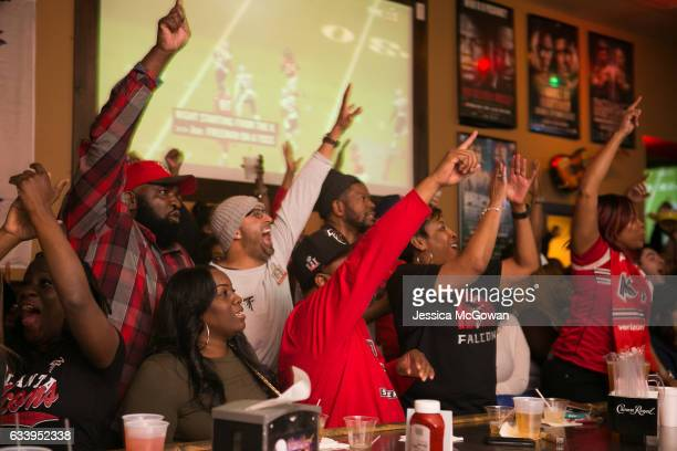 Atlanta Falcons fans cheer for their team while watching Super Bowl 51 against the New England Patriots at Dugan's bar on February 5, 2017 in...