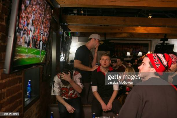 Atlanta Falcons fans react while watching Super Bowl 51 against the New England Patriots at STATS on February 5 2017 in Atlanta Georgia