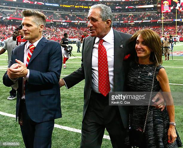 Atlanta Falcons general manager Thomas Dimitroff team owner Arthur Blank and Angela Macuga celebrate their 3734 overtime win over the New Orleans...