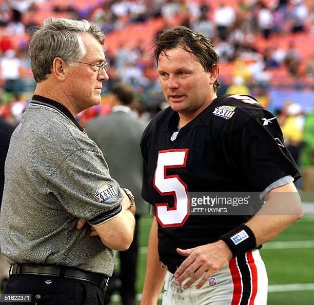 Atlanta Falcons head coach Dan Reeves talks to Falcons kicker Morten Andersen before the start of Super Bowl XXXIII 31 January at Pro Player Stadium...