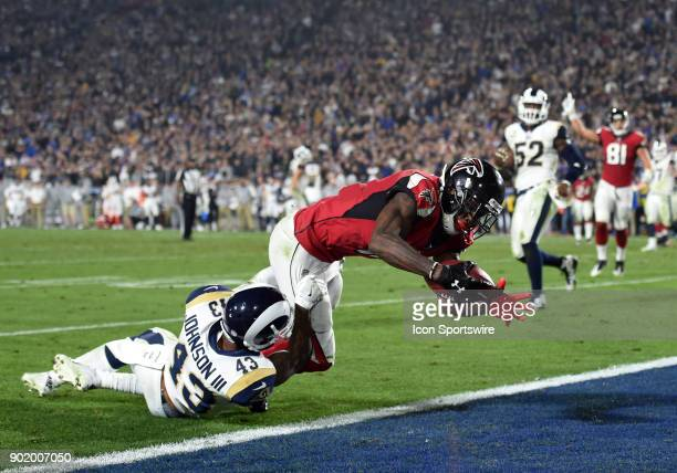 Atlanta Falcons Julio Jones catches a pass and runs the ball into the endzone for a touchdown against Los Angeles Rams Safety John Johnson in the...