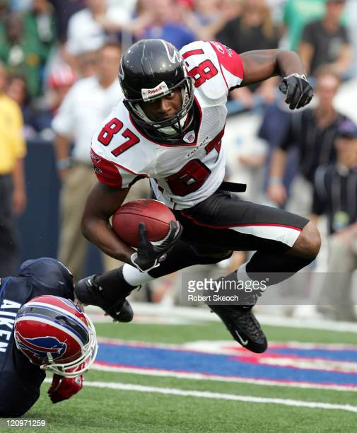 Atlanta Falcons kickoff return Romby Bryant moves the ball upfield before being dumped by Sam Aiken during the game against the Buffalo Bills at...