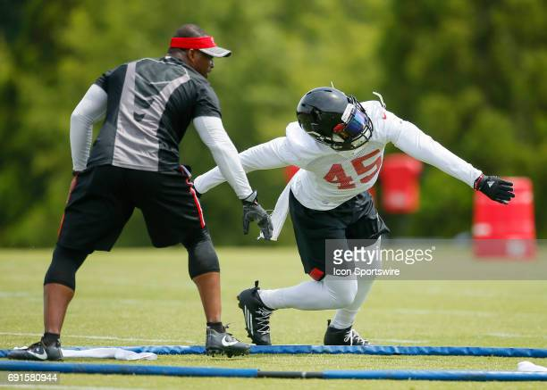 Atlanta Falcons middle linebacker Deion Jones takes part in a drill during a football practice in Flowery Branch Ga