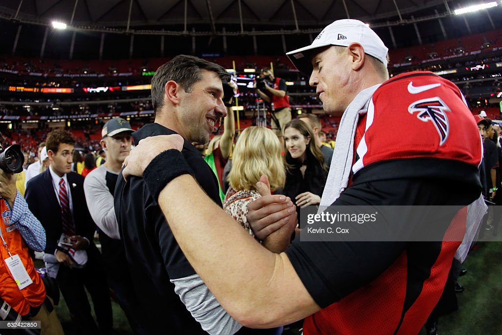 Atlanta Falcons offensive coordinator Kyle Shanahan celebrates with Matt Ryan #2 after defeating the Green Bay Packers in the NFC Championship Game at the Georgia Dome on January 22, 2017 in Atlanta, Georgia. The Falcons defeated the Packers 44-21.