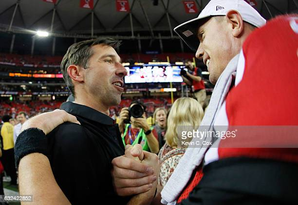 Atlanta Falcons offensive coordinator Kyle Shanahan celebrates with Matt Ryan after defeating the Green Bay Packers in the NFC Championship Game at...