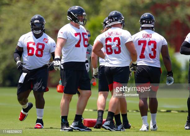 Atlanta Falcons offensive tackle Kaleb McGary and offensive guard Chris Lindstrom run through a drill during Atlanta Falcons minicamp in Flowery...