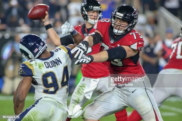 Atlanta Falcons offensive tackle Ryan Schraeder blocks Los Angeles Rams outside linebacker Robert Quinn during the NFC Wild Card football game...
