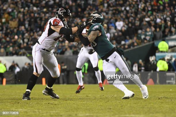 Atlanta Falcons offensive tackle Ryan Schraeder blocks Philadelphia Eagles defensive end Chris Long during the NFC Divisional Playoff game between...