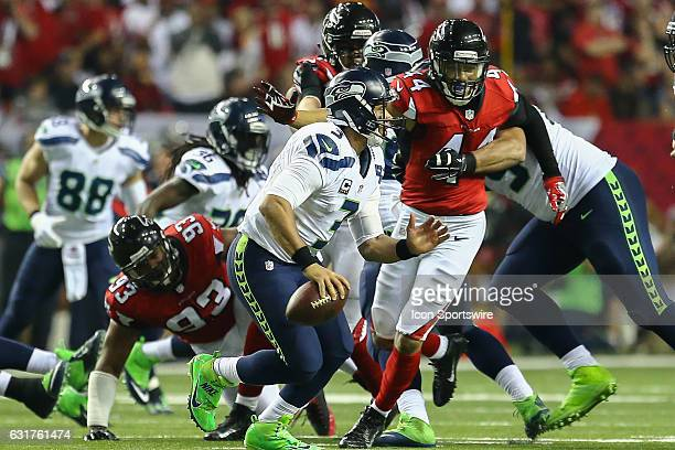 Atlanta Falcons outside linebacker Vic Beasley rushes Seattle Seahawks quarterback Russell Wilson during the NFC Divisional Playoff game between the...