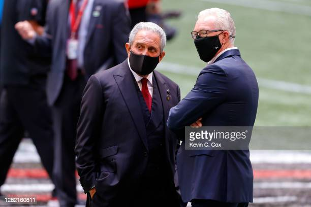 Atlanta Falcons owner Arthur Blank and Detroit Lions president and CEO Rod Wood speak prior to the game at Mercedes-Benz Stadium on October 25, 2020...