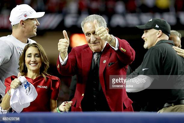Atlanta Falcons owner Arthur Blank celebrates after defeating the Green Bay Packers with Angela Macuga in the NFC Championship Game at the Georgia...
