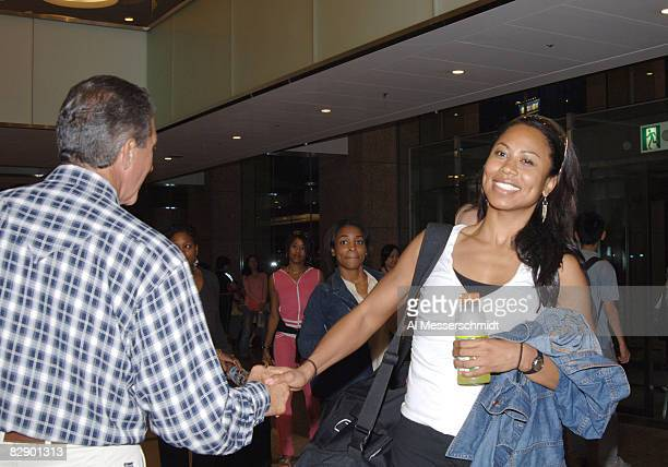 Atlanta Falcons owner Arthur Blank greets cheerleader Sandra Fields as she arrives at the Tokyo Dome Hotel in Tokyo Japan on August 3 2005