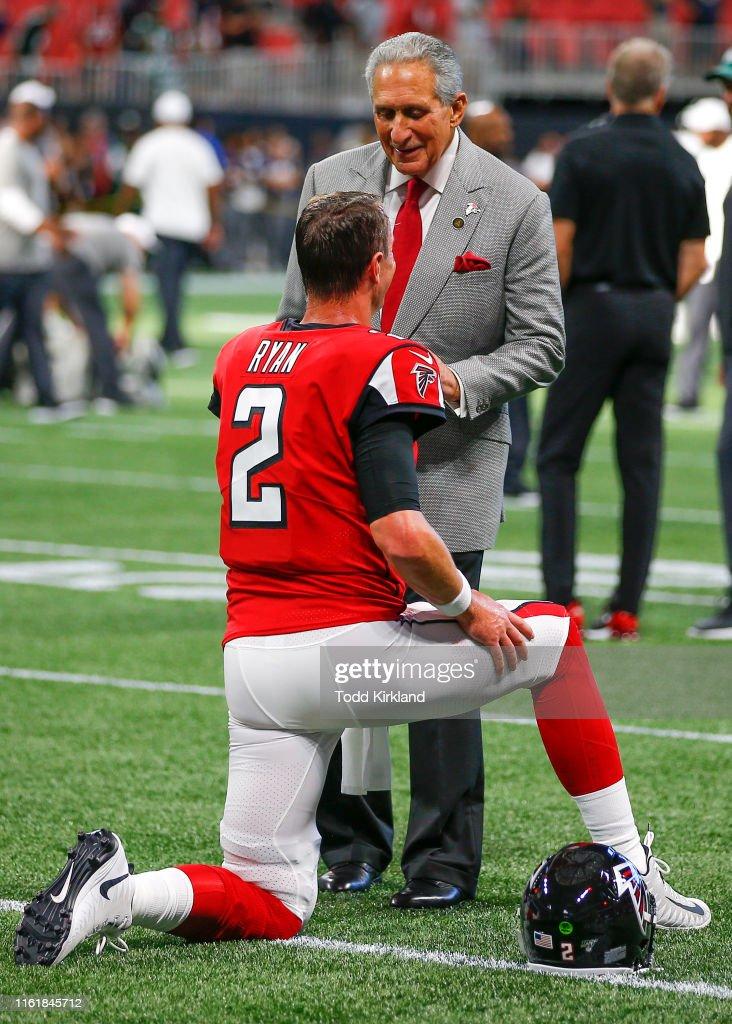 Atlanta Falcons owner Arthur Blank speaks with Matt Ryan
