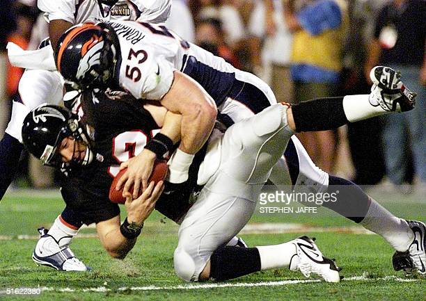 Atlanta Falcons quarterback Chris Chandler is sacked by Denver Broncos linebacker Bill Romanowski in the first quarter of Super Bowl XXXIII 31...