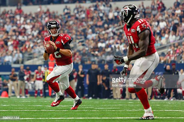Atlanta Falcons Quarterback Matt Ryan [10265] rolls out for a touchdown pass to Wide Receiver Julio Jones [16214] during the NFL game between the...