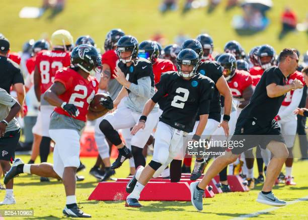 Atlanta Falcons quarterback Matt Ryan and Atlanta Falcons running back Devonta Freeman take part of a drill on August 01 2017 during the Atlanta...