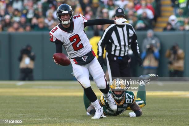 Atlanta Falcons quarterback Matt Ryan escapes the grasp of Green Bay Packers defensive back Josh Jones during a game between the Green Bay Packers...