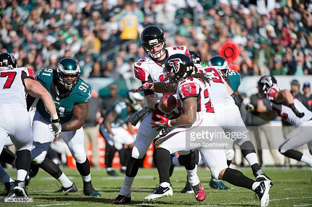 Atlanta Falcons Quarterback Matt Ryan hands the ball off to Atlanta Falcons Running Back Devonta Freeman in the first half during the game between...