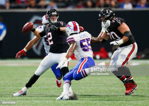 Atlanta Falcons quarterback Matt Ryan is pressured by Buffalo Bills outside linebacker Lorenzo Alexander and defensive end Jerry Hughes during an NFL...
