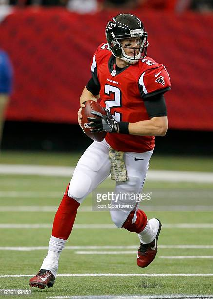 Atlanta Falcons quarterback Matt Ryan rolls out to pass during first half action of an NFL football game between the Arizona Cardinals and the...
