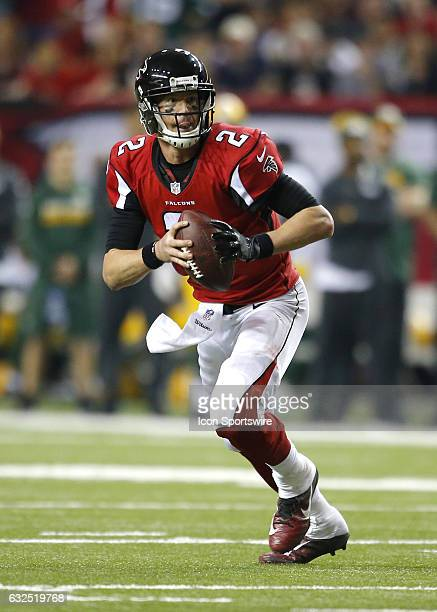 Atlanta Falcons quarterback Matt Ryan rolls out to pass in the second half of the NFC Championship game between the Green Bay Packers and Atlanta...