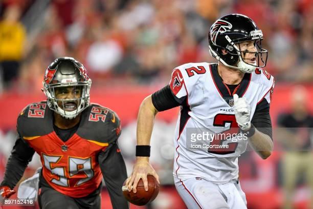 Atlanta Falcons quarterback Matt Ryan scrambles away from Tampa Bay Buccaneers linebacker Devante Bond during an NFL game between the Atlanta Falcons...
