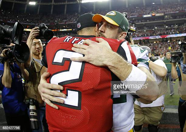 Atlanta Falcons quarterback Matt Ryan speaks with Green Bay Packers quarterback Aaron Rodgers at the conclusion of the NFC Championship game between...