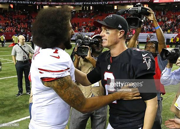 Atlanta Falcons quarterback Matt Ryan speaks with San Francisco 49ers quarterback Colin Kaepernick at the conclusion of an NFL football game between...