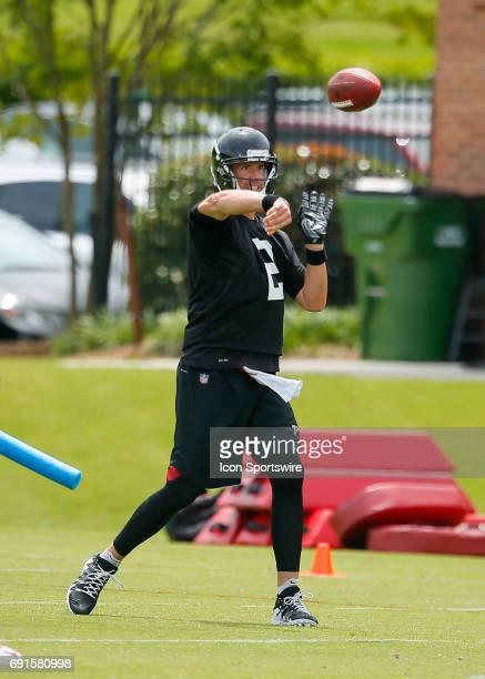 Atlanta Falcons quarterback Matt Ryan takes part in a drill during a football practice in Flowery Branch Ga