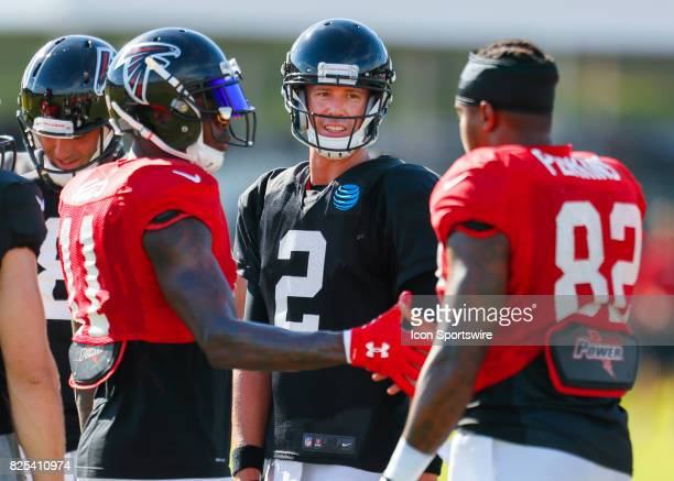 Atlanta Falcons quarterback Matt Ryan wide receiver Julio Jones and tight end Josh Perkins speak on August 01 2017 during the Atlanta Falcons...