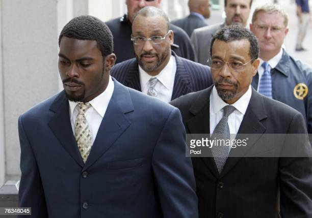Atlanta Falcons quarterback Michael Vick arrives at federal court with attorney Billy Martin August 27 2007 in Richmond Viriginia Vick pleaded guilty...